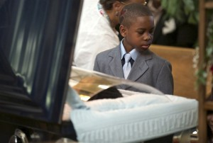 child at funeral crop