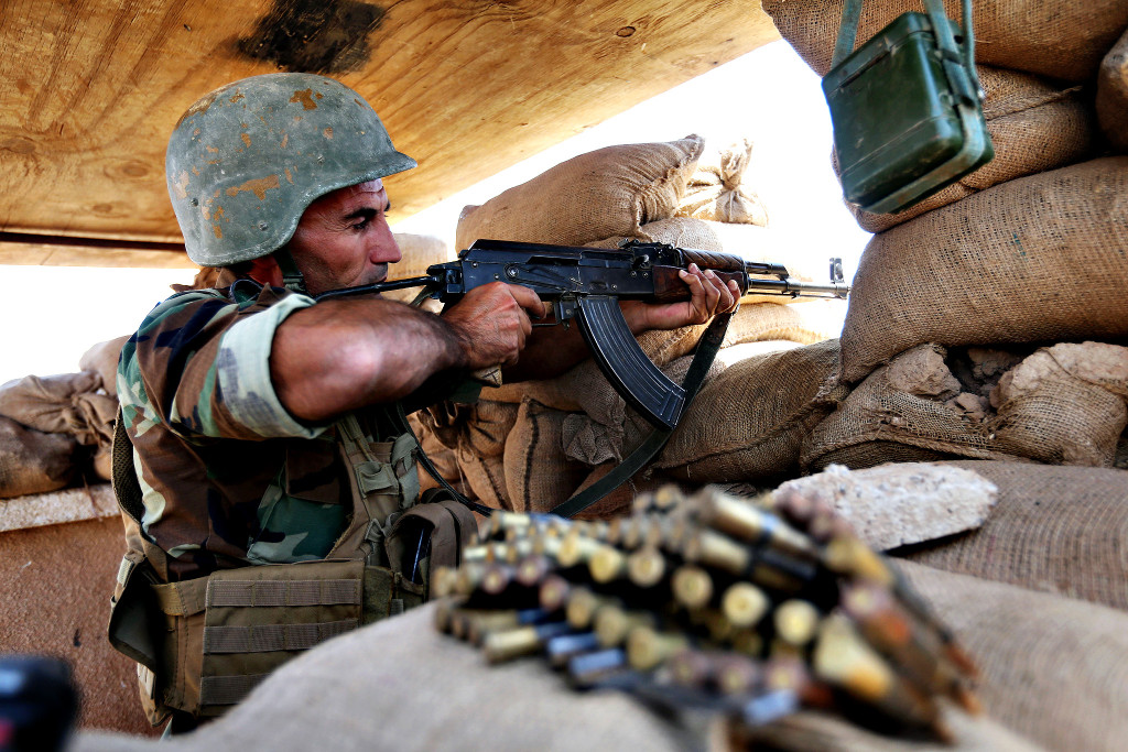 A Kurdish peshmerga fighter takes his position on the front line