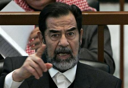 Ousted Iraqi President Saddam Hussein reacts in court during the Anfal genocide trial