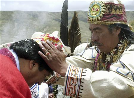 File photo of Bolivian President-elect Morales being blessed by Aymara priest Valentin Mejillones during a ceremony at Tiawanaku