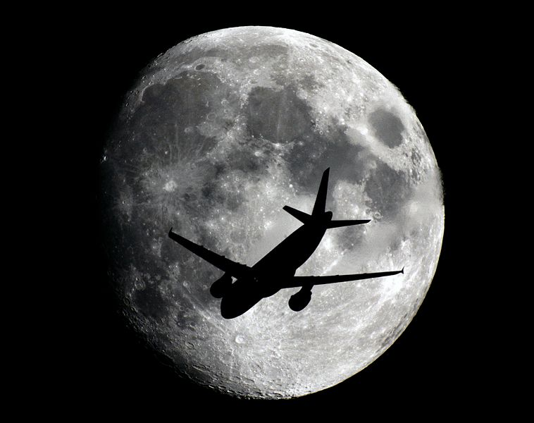 Waxing Gibbous moon and plane