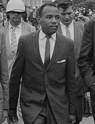 James Meredith, shown walking to class with U.S. Marshals, was an Air Force  veteran seeking to become a GI Bill student at the University of  Mississippi.